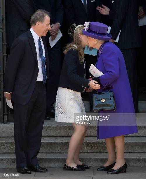 Queen Elizabeth II kisses Lady Margarita ArmstrongJones as her father David ArmstrongJones looks on as they leave a Service of Thanksgiving for the...