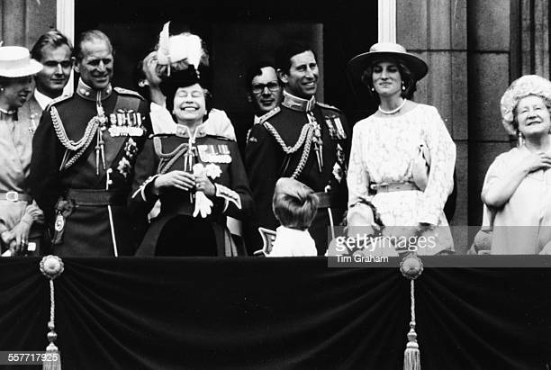 HM Queen Elizabeth II laughing at her little grandsons Harry and William on the balcony of Buckingham Palace with Prince Philip Prince Charles...