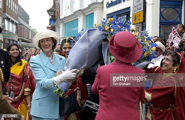Queen Elizabeth II Laughing With Her Ladyinwaiting Lady Susan Hussey As They Gather Bouquets Of Flowers During A Walkabout On Her Jubilee Tour