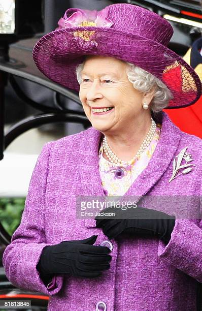 Queen Elizabeth II laughs as she arrives in the parade ring in a horse drawn carriage on the Second Day of Royal Ascot on June 18 2008 in Ascot...