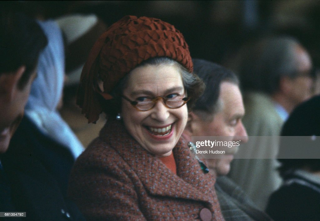Queen Elizabeth II laughs as she attends the Royal Windsor horse show, Windsor, England, 1975.
