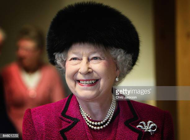 Queen Elizabeth II laughs as she is taken on a tour of the Carole Brown Health Centre on February 3, 2009 in Dersingham, England. The Queen attended...