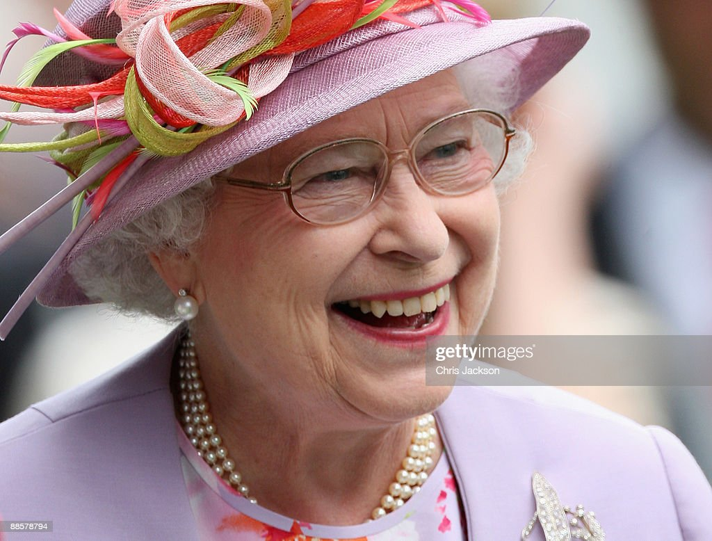 HM Queen Elizabeth II laughs in the parade ring on day four of Royal Ascot 2009 at Ascot Racecourse on June 19, 2009 in Ascot, England.