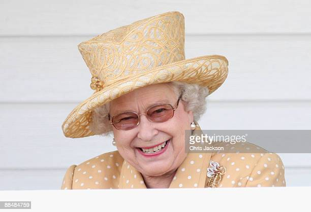 Queen Elizabeth II laughs in the Royal Box as she attends the Queen's Cup final at Guards Polo Club on June 14, 2009 in Egham, England.