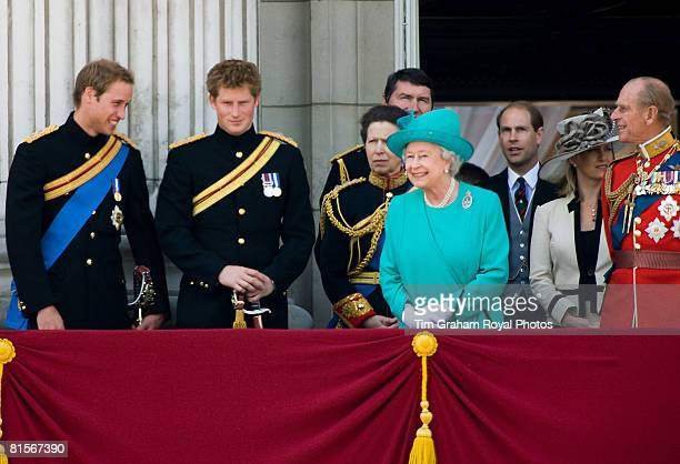 Queen Elizabeth II laughs with Prince William who joins her along with Prince Harry and Prince Philip Duke of Edinburgh on the balcony of Buckingham...