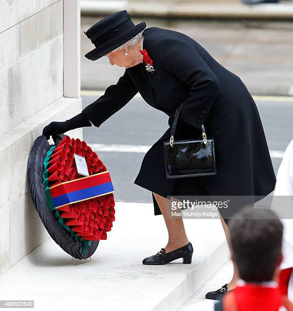Queen Elizabeth II lays a wreath as she attends the annual Remembrance Sunday Service at the Cenotaph on Whitehall on November 8 2015 in London...