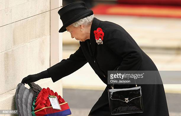 Queen Elizabeth II lays a wreath as she attends the Remembrance Sunday Service at the Cenotaph on November 9, 2008 in London, England. This year is...