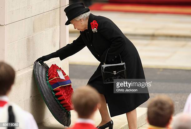 Queen Elizabeth II lays a wreath as she attends the Remembrance Sunday Service at the Cenotaph on November 9 2008 in London England This year is the...