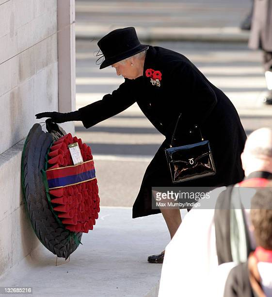 Queen Elizabeth II lays a wreath as she attends the Remembrance Day Ceremony at the Cenotaph on November 13 2011 in London United Kingdom
