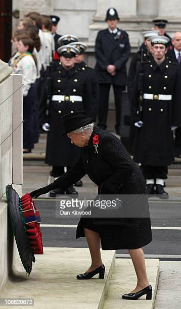 Queen Elizabeth II lays a wreath at the Cenotaph during Remembrance Sunday in Whitehall on November 14 2010 in London England Remembrance Sunday...