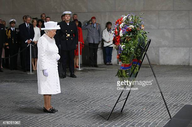 Queen Elizabeth II lays a wreath at the Central Memorial for the victims of war and dictatorship on the second day of a four day State Visit on June...