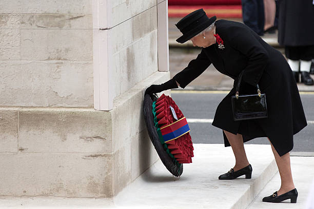 Queen Elizabeth II lays a wreath during the annual Remembrance Sunday Service at the Cenotaph on Whitehall on November 8 2015 in London United...