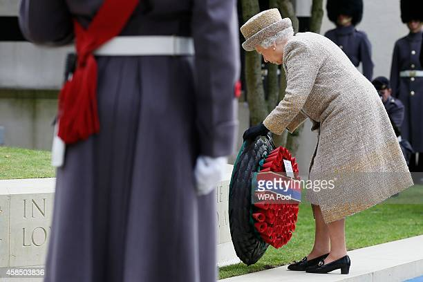 Queen Elizabeth II lays a wreath during the Opening of the Flanders' Fields Memorial Garden at Wellington Barracks on November 6 2014 in London...