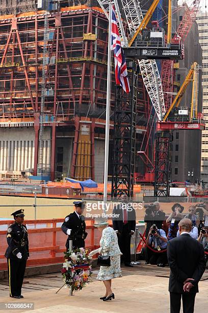 Queen Elizabeth II lays a wreath in remembrance of the victims of the attacks on September 11 during a visits to Ground Zero at the World Trade...