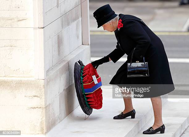 Queen Elizabeth II lays her wreath as she attends the annual Remembrance Sunday Service at the Cenotaph on Whitehall on November 13 2016 in London...