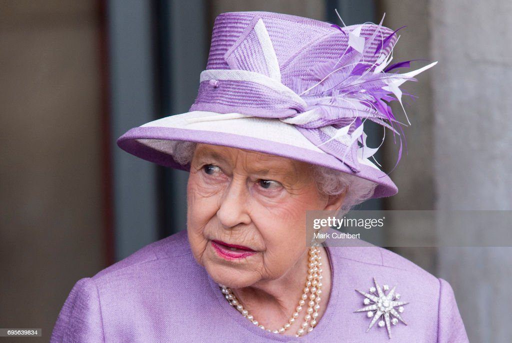 Queen Elizabeth II leaves after attending Evensong in celebration of the centenary of the Order of the Companions of Honour at Hampton Court Palace on June 13, 2017 in London, England.