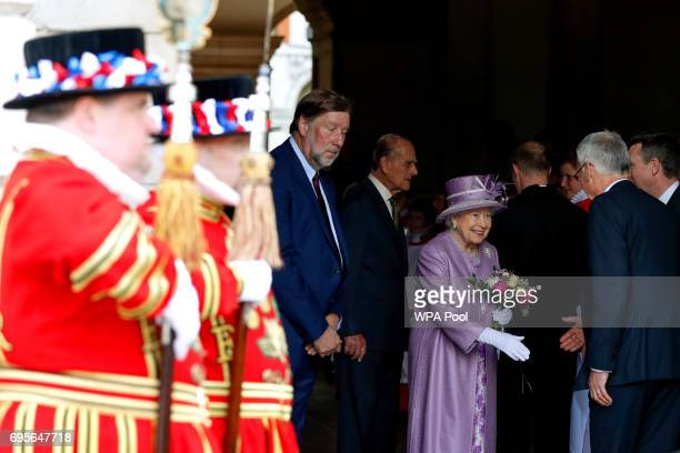 Queen Elizabeth II leaves an Evensong service in celebration of the centenary of the Order of the Companions of Honour at Hampton Court Palace on...