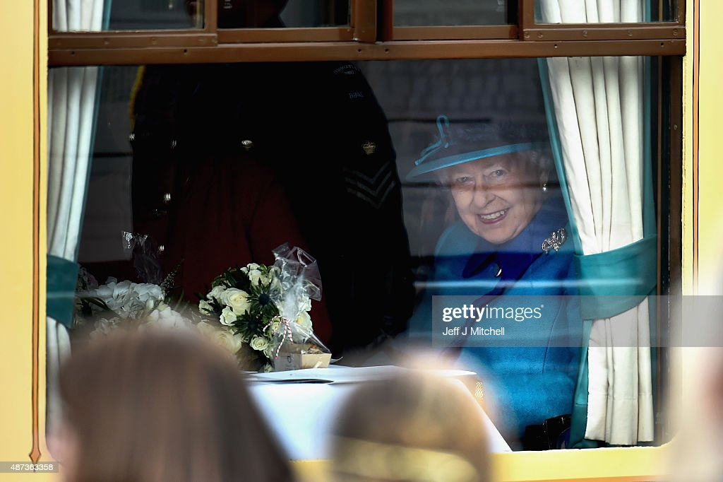 Queen Elizabeth II leaves Newtongrange Station on the steam locomotive the 'Union of South Africa' on September 9, 2015 in Newtongrange , Scotland.Today, Her Majesty Queen Elizabeth II becomes the longest reigning monarch in British history overtaking her great-great grandmother Queen Victorias record by one day. The Queen has reigned for a total of 63 years and 217 days. Accompanied by her husband The Duke of Edinburgh, she has today opened the new Scottish Borders Railway.