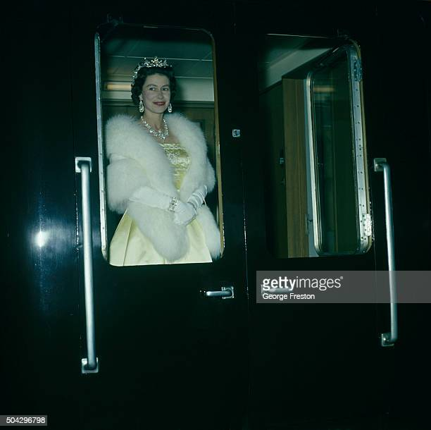 Queen Elizabeth II leaves on a train from Liverpool after attending an ice show 24th May 1961