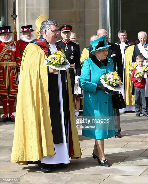 Queen Elizabeth II leaves Sheffield Cathedral after the traditional Royal Maundy Service at Sheffield Cathedral on April 2 2015 in Sheffield England