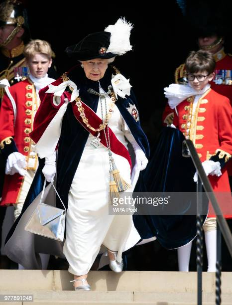 Queen Elizabeth II leaves St George's Chapel after attending the annual Order of the Garter Service in Windsor Castle on June 18 2018 in Windsor...