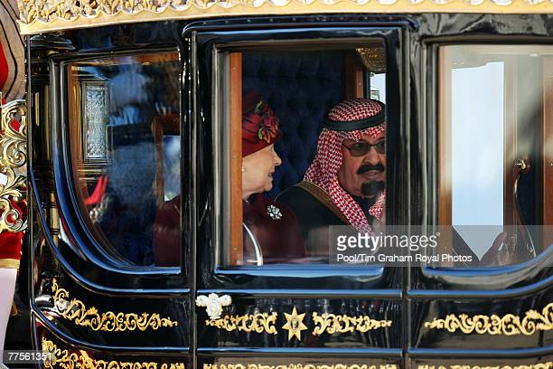 Queen Elizabeth II leaves the Horse Guards Parade with King Abdullah Bin Abdul Aziz Al Saud of Saudi Arabia in a royal carriage at the start of his...