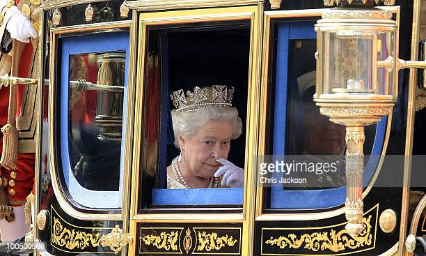 Queen Elizabeth II leaves the Houses of Parliament in her carriage during the State Opening of Parliament in the Houses of Parliament on May 25 2010...