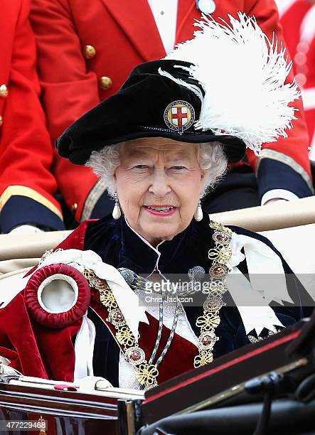 Queen Elizabeth II leaves the Order of the Garter Service at St George's Chapel in a royal carriage at Windsor Castle on June 15 2015 in Windsor...