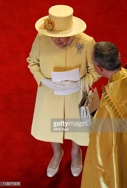 Queen Elizabeth II leaves the Westminster Abbey after the wedding ceremony of Prince William and Kate Middleton on April 29 2011 in LondonEngland