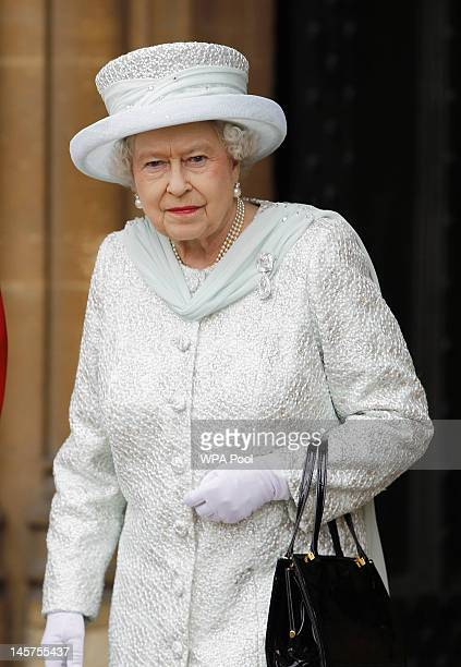 Queen Elizabeth II leaves Westminster Hall after a Diamond Jubilee Luncheon given for The Queen by The Livery Companies of The City of London on June...