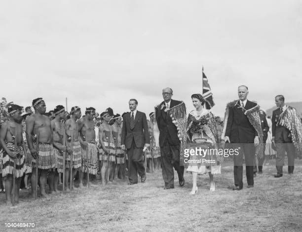 Queen Elizabeth II leaving a Maori reception in her honour, at Arawa Park, Rotorua, New Zealand, during her coronation world tour, 2nd January 1954....