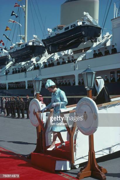 Queen Elizabeth II leaving the Royal yacht Britannia on arrival in Bahrain during her tour of the Gulf States 14th February 1979