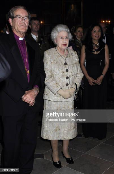 Queen Elizabeth II listens to a speech by Christopher Moran during a reception and dinner to celebrate the 70th Anniversary of The Council of...