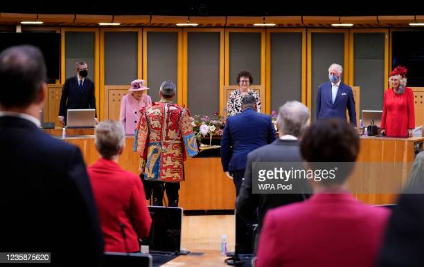 Queen Elizabeth II, Llywydd Elin Jones, Prince Charles, Prince of Wales, Camilla, Duchess of Cornwall arrive at the Siambr during the ceremonial...