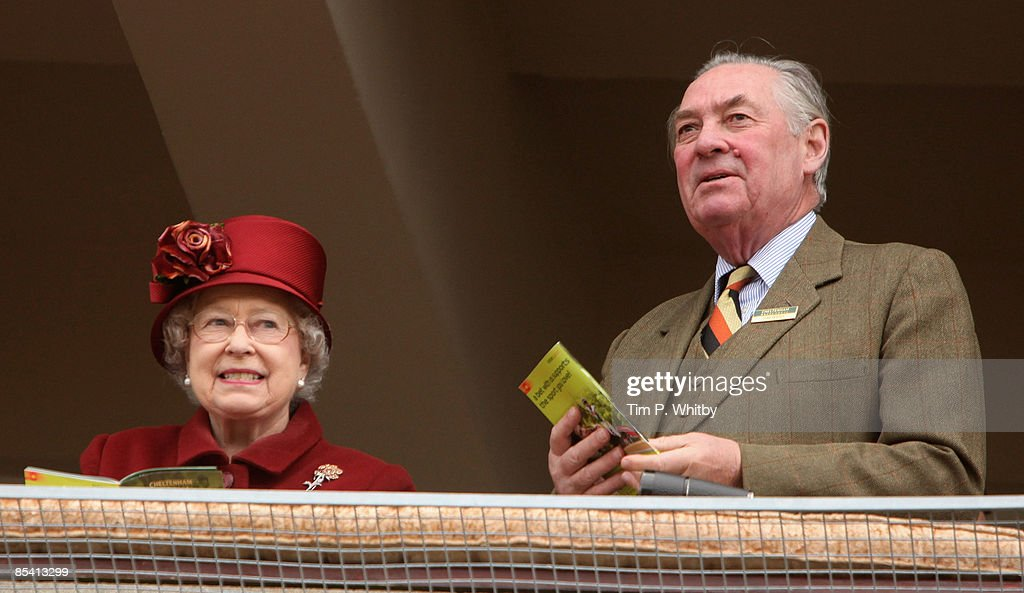 Queen Elizabeth II looks and Lord Sam Vestey attend Day Four of the Cheltenham Festival at the Cheltenham racecourse on March 13, 2009 in Cheltenham, England.