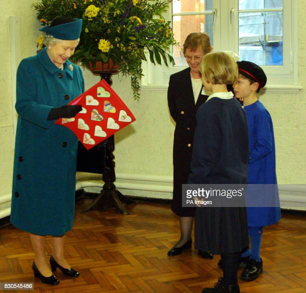 Queen Elizabeth II looks at a Valentine card penned by the children at St Clement Danes School in London The message in the card read 'Dear Your...