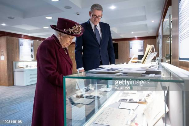 Queen Elizabeth II looks at artifacts relating to MI5 DDay operations with Director General Andrew Parker during a visit to the headquarters of MI5...
