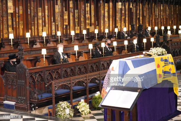 Queen Elizabeth II looks at the coffin of her husband the Duke of Edinburgh during his funeral service in St George's Chapel at Windsor Castle on...