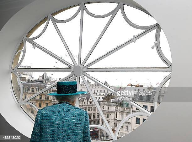 Queen Elizabeth II looks at the view out of a window during a visit to reopen Canada House on Trafalgar Square following an extensive programme of...