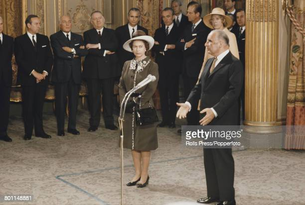 Queen Elizabeth II looks on as President of France Georges Pompidou makes a speech at the Elysee Palace in Paris at the start of a state visit by the...