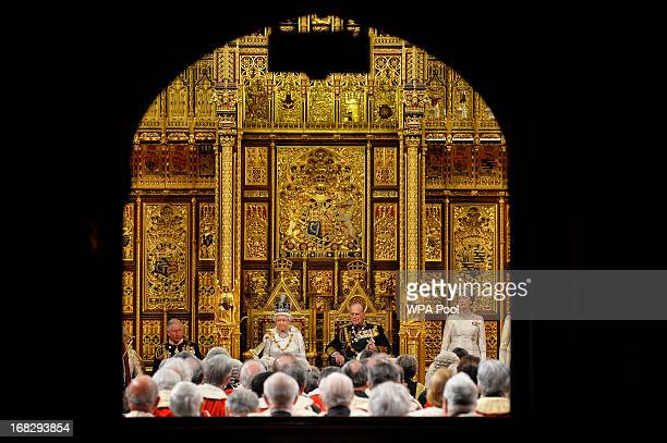 Queen Elizabeth II looks on before delivering her speech during the State Opening of Parliament at the House of Lords alongside Prince Philip The...
