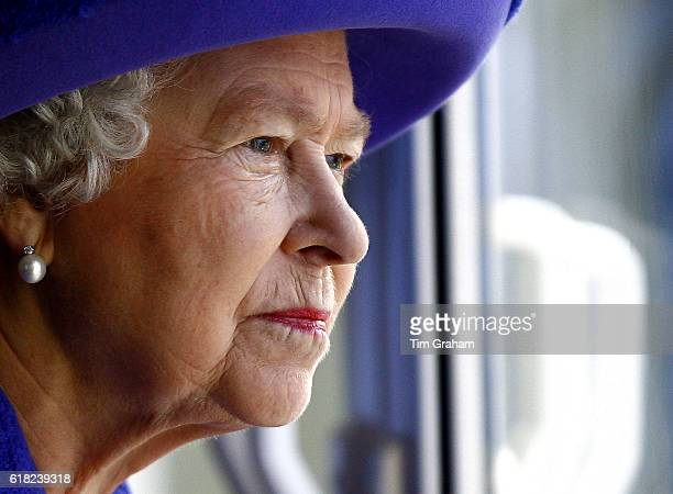 Queen Elizabeth II looks out from a window at the underwater stage at Pinewood Studios   Location Iver Heath England United Kingdom
