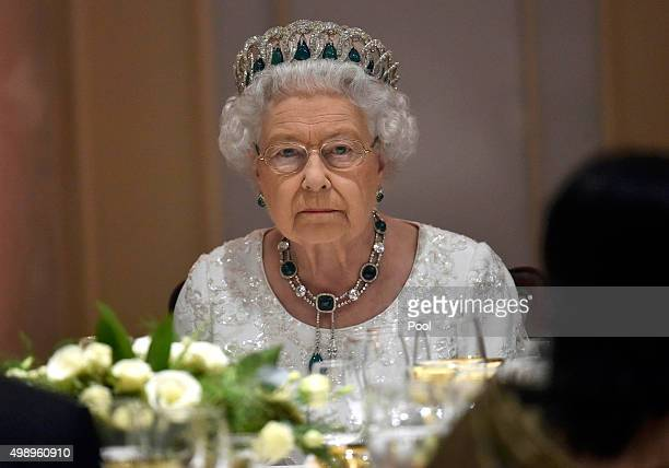 Queen Elizabeth II looks serious as she attends a dinner at the Corinthia Palace Hotel in Attard during the Commonwealth Heads of Government Meeting...