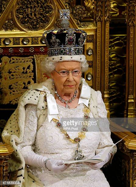 Queen Elizabeth II looks up during the Queen's Speech to the House of Lords in the Palace of Westminster on May 27 2015 in London England The Queens...