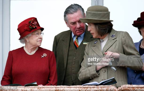 Queen Elizabeth II, Lord Samuel Vestey and Lady Celia Vestey attend day 4 'Gold Cup Day' of the Cheltenham Festival at Cheltenham Racecourse on March...