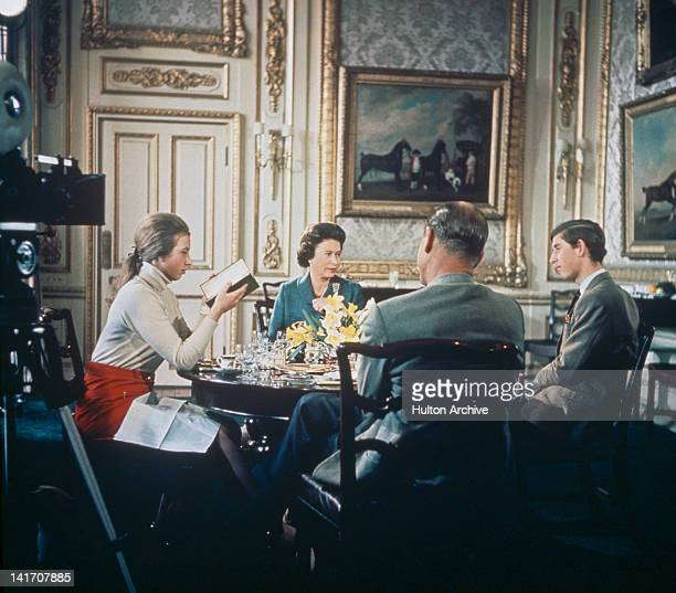 Queen Elizabeth II lunches with Prince Philip and their children Princess Anne and Prince Charles at Windsor Castle in Berkshire circa 1969 A camera...