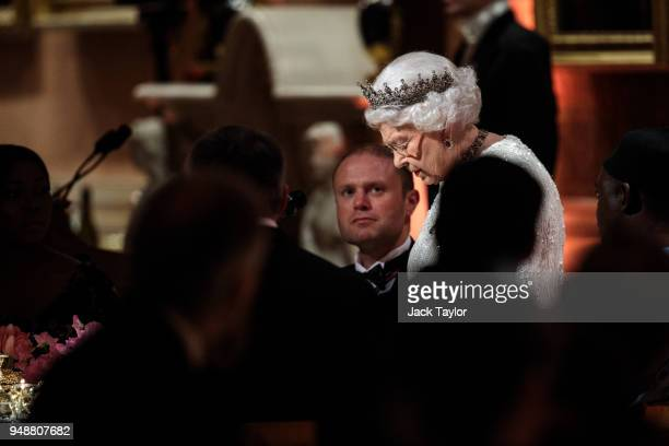Queen Elizabeth II makes a short speech at the Queen's Dinner at Buckingham Palace in the week of the 'Commonwealth Heads of Government Meeting' on...