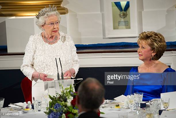 Queen Elizabeth II makes a speech as she attends the State Dinner on the second day of her State Visit, at Dublin Castle, on May 18, 2011 in Dublin,...