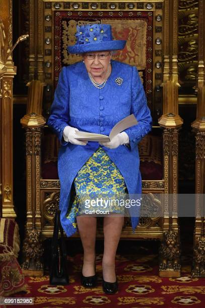 Queen Elizabeth II makes a speech at the State Opening Of Parliament in the House of Lords on June 21 2017 in London England This year saw a...