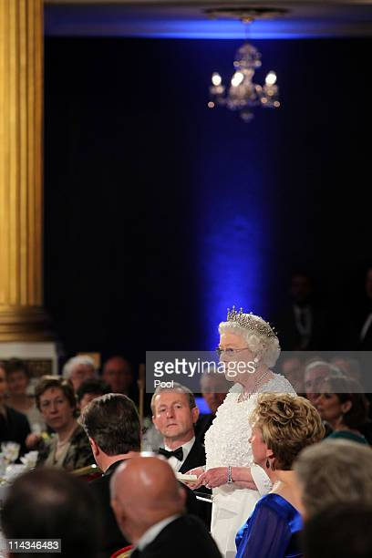 Queen Elizabeth II makes a speech watched by Irish Taoiseach Enda Kenny and President Mary McAleese during a State Dinner at Dublin Castle on May 18...